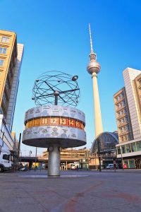 20527354 - berlin, germany - june 18: alexanderplatz, tv tower and world clock view on june 18, 2013,berlin, germany. alexanderplatz is a large public square and train station in mitte district of berlin.